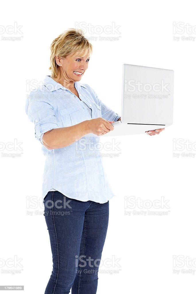 Mature woman very angry with the modern technology royalty-free stock photo