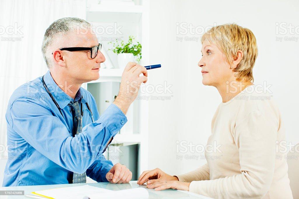 Mature Woman VIsit Doctors Office stock photo