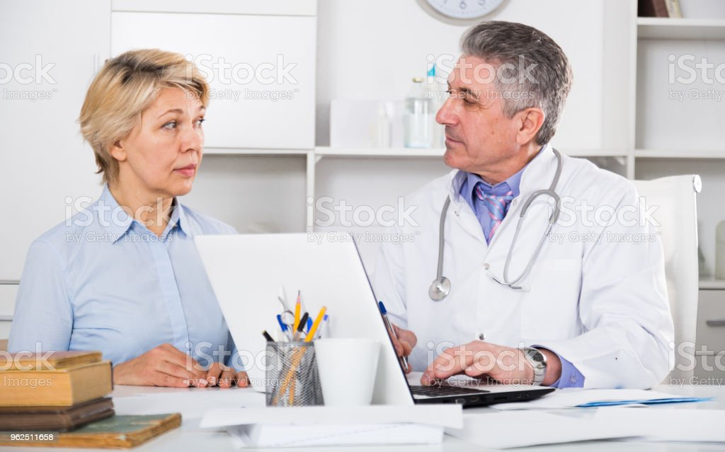 Mature woman visits doctor - Royalty-free Adult Stock Photo