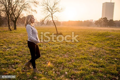 851958232istockphoto Mature woman walking in autumn park while listening to music 629255250