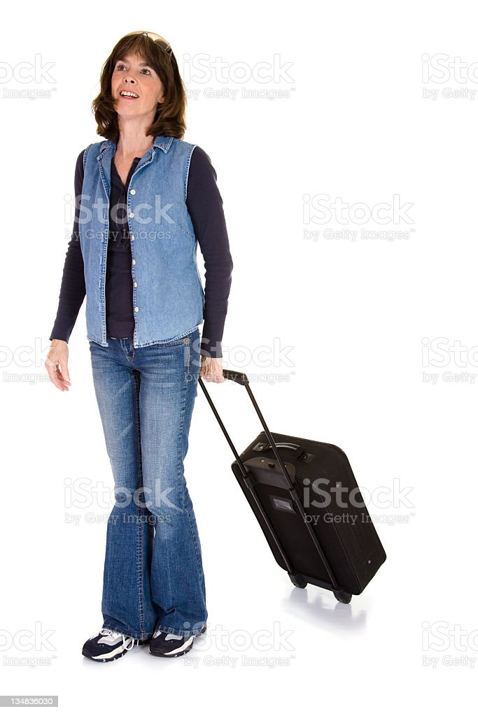 Mature woman walking with luggage royalty-free stock photo