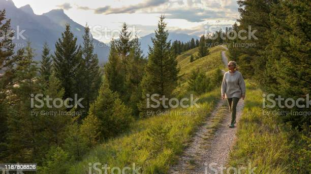 Mature woman walks down trail in the morning picture id1187808826?b=1&k=6&m=1187808826&s=612x612&h=2sqxgapiqnp5czjnq ez4xosuyvbrw6mjjjl3gevkuc=
