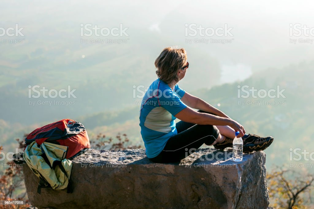Mature woman watching, seated,autumn,Italy,Europe zbiór zdjęć royalty-free