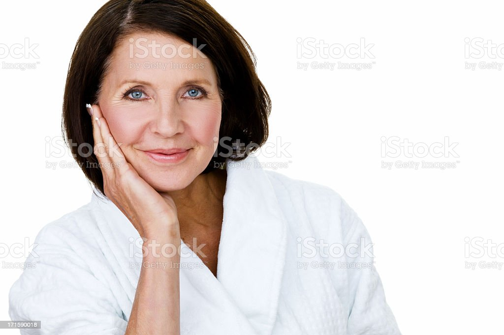 Mature woman wearing a bathrobe stock photo