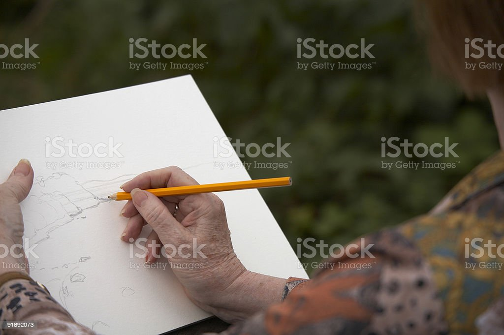 Mature woman whit pencil and paper stock photo