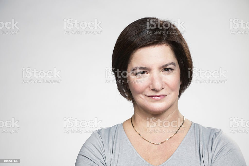 Mature woman with a smart no-nonsense expression royalty-free stock photo