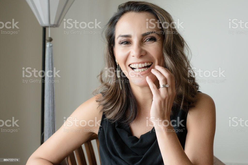 Mature woman with braces stock photo
