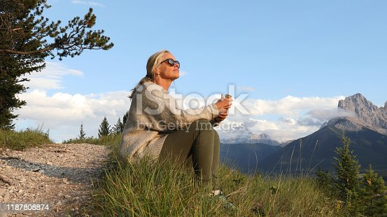 She looks out to mountain ranges in distance
