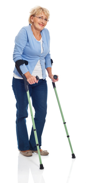 Mature Woman With Crutches Stock Photo - Download Image Now