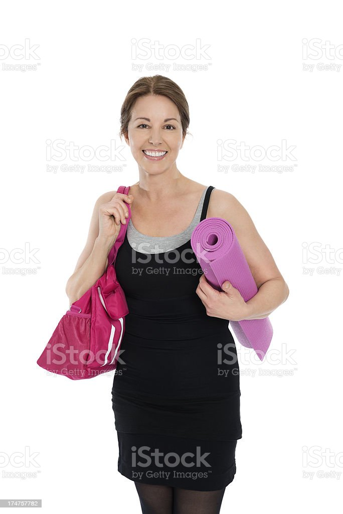 Mature Woman With Exercise Mat And Gym Bag royalty-free stock photo