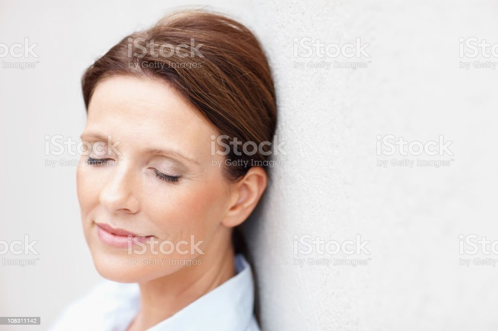 Mature woman with eyes closed stock photo