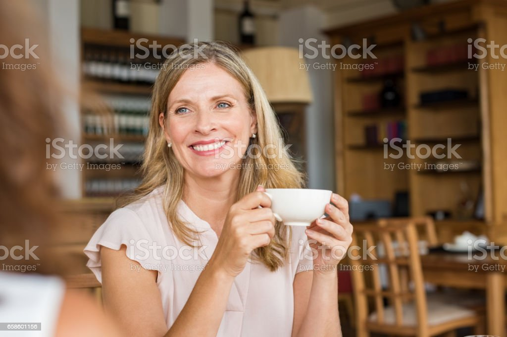 Mature woman with friend stock photo