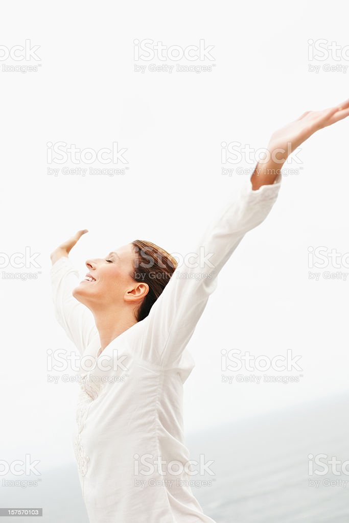 Mature woman with her arms outstretched royalty-free stock photo