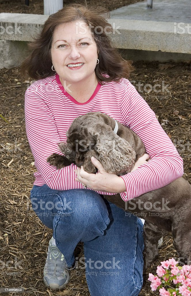 Mature woman with her cocker spaneil royalty-free stock photo