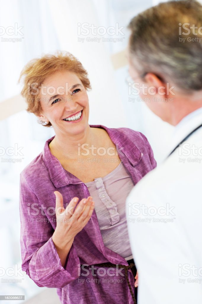 Mature woman with her doctor. royalty-free stock photo