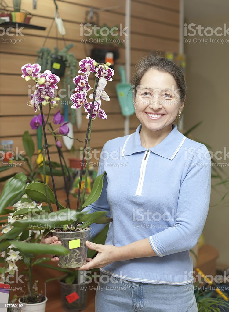 mature woman with Phalaenopsis orchid royalty-free stock photo
