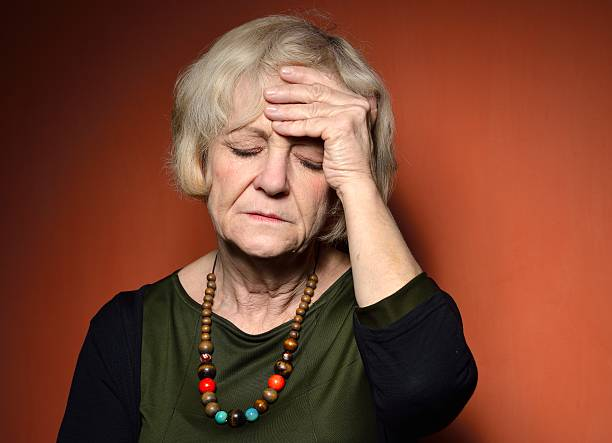 Mature woman with problems. stock photo