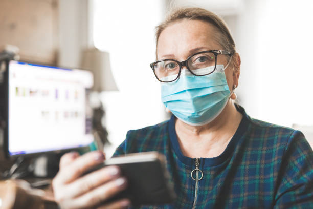 Mature woman with protective mask stock image stock photo