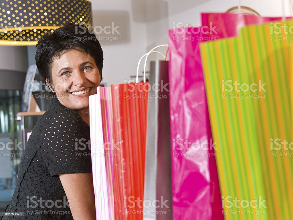 Mature woman with shopping bags royalty-free stock photo