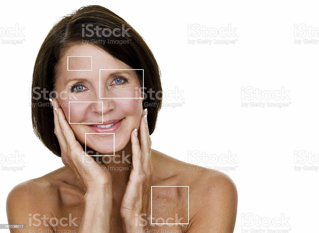 Mature woman with skin care representation bildbanksfoto