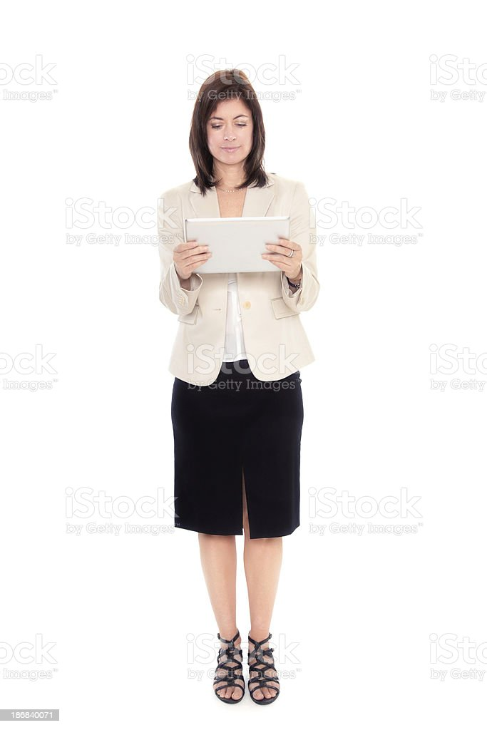 Mature woman with tablet full length stock photo