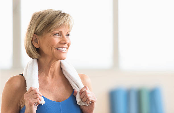 Mature Woman With Towel Around Neck stock photo