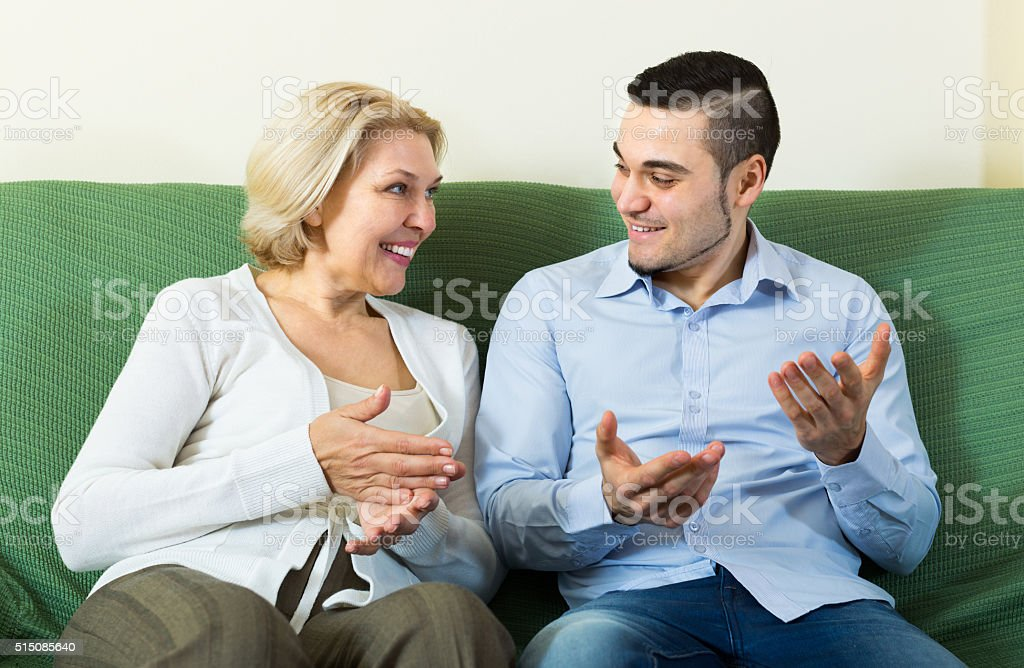 Mature woman with young boyfriend stock photo