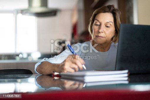 istock Mature woman working at home 1143057831