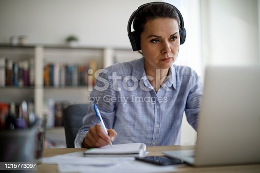 Mature woman working from home during COVID-19 pandemic