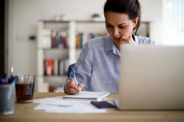 Mature woman working from home stock photo