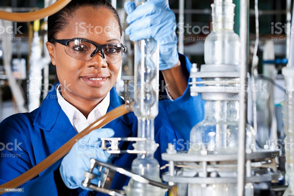 Mature woman working in chemical plant stock photo