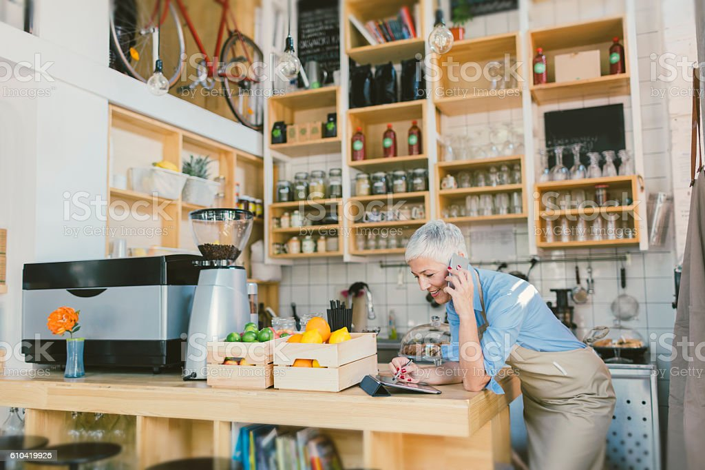 Mature Woman Working In Her Cafe stock photo