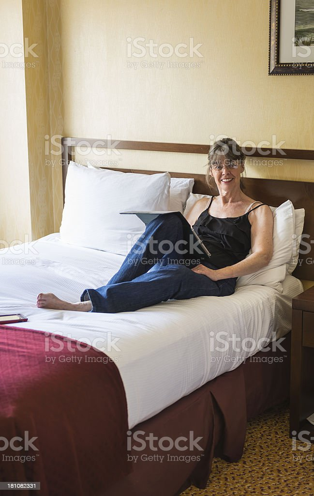 Mature woman working on digital tablet royalty-free stock photo