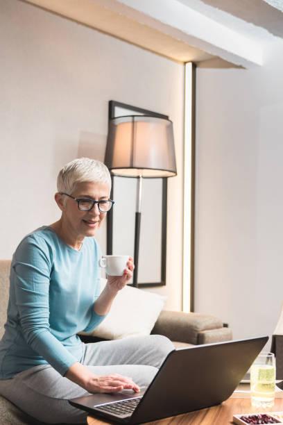 Mature woman working on her laptop picture id1133407152?b=1&k=6&m=1133407152&s=612x612&w=0&h=xu ospne3rzcbp9fvfmsovaovyfbffkrc9h4rk572dm=