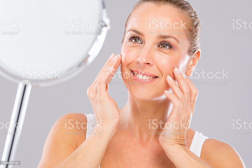 Mature woman, wrinkles and beauty. stock photo