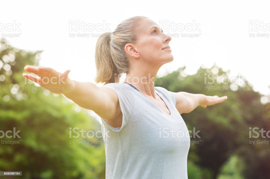 Mature woman yoga exercise stock photo