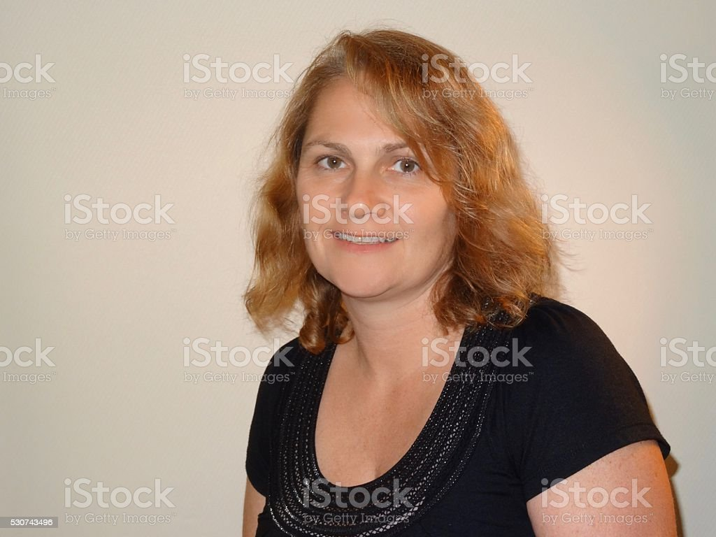 Mature woman's smiling face - side on stock photo