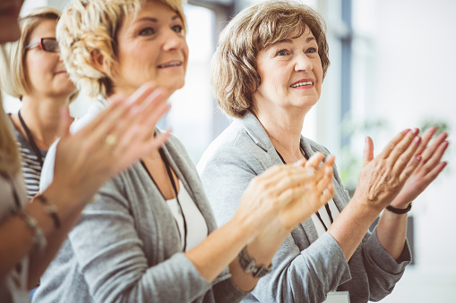 Mature Women Clapping Hands During Seminar Stock Photo - Download Image Now