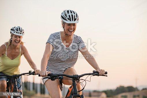 istock Mature Women Cycling in the Sun 1077182602