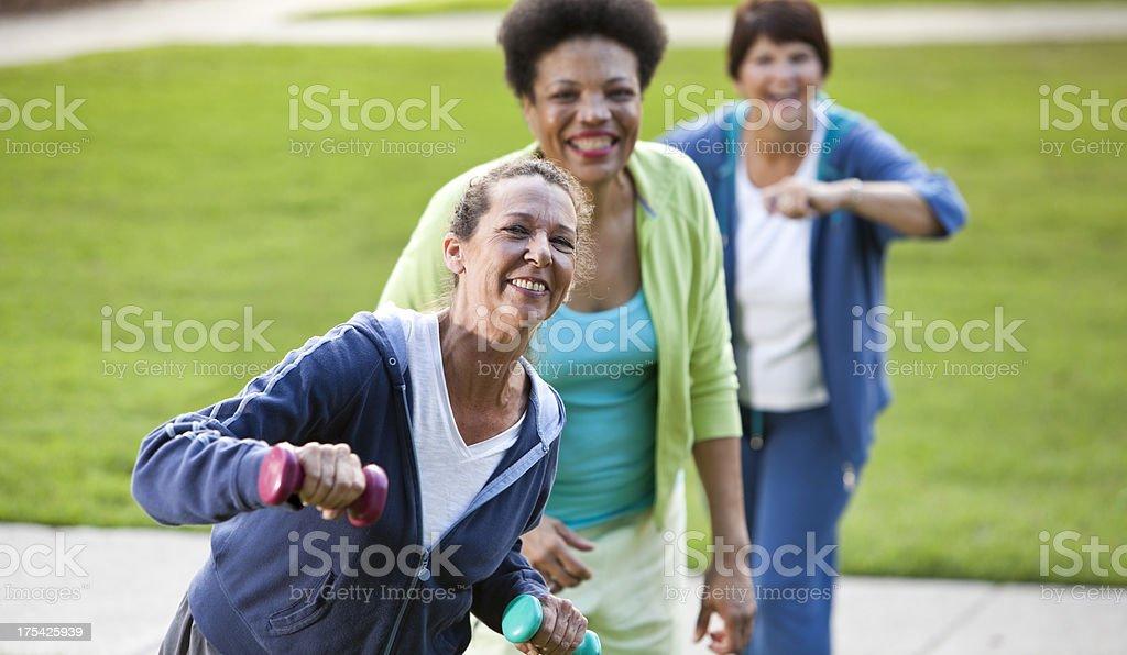 Mature women exercising outdoors royalty-free stock photo