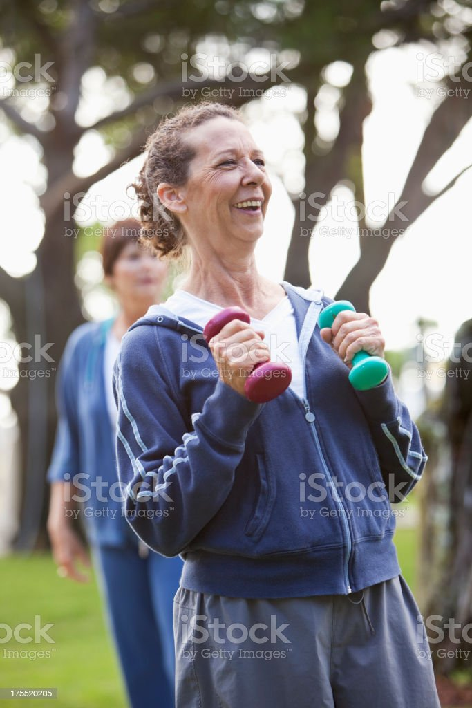Mature women exercising outdoors stock photo