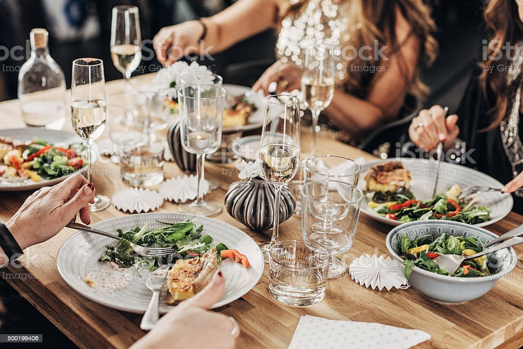 Mature women having dinner party stock photo
