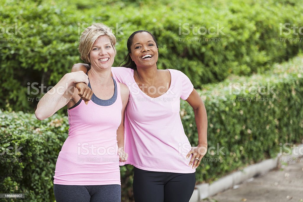 Mature women in pink workout clothing stock photo