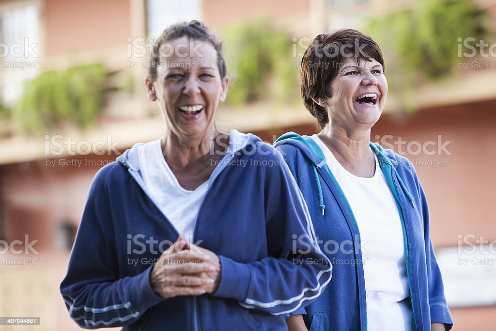 Mature women in sweatsuits having fun stock photo