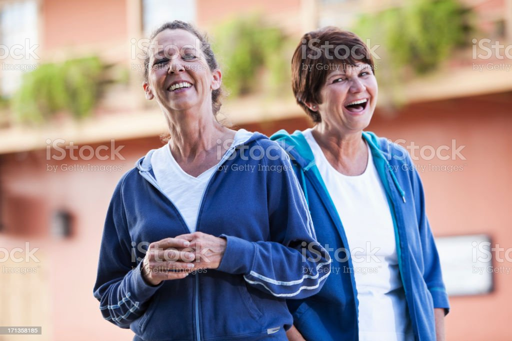 Mature women in sweatsuits stock photo