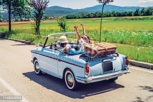 Mature Women on a Road Trip With Old-fashioned Convertible.