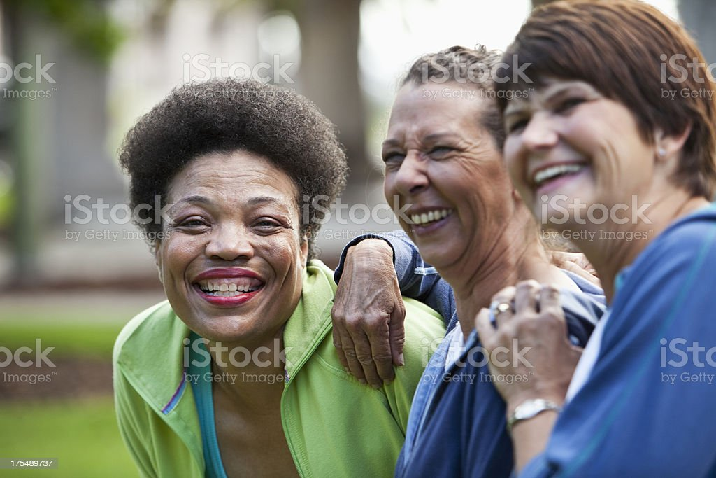 Mature women smiling and laughing outdoors stock photo