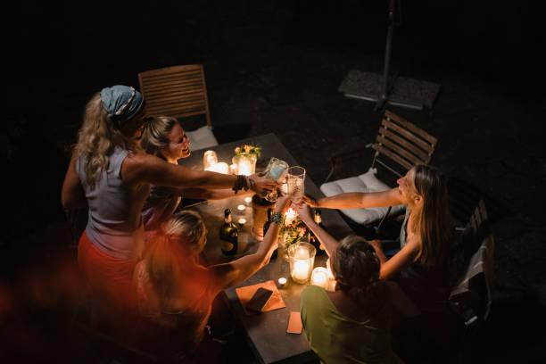 Mature Women Toasting at Night stock photo