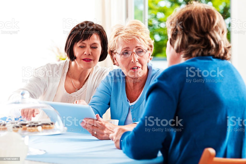 Mature women using digital tablet royalty-free stock photo