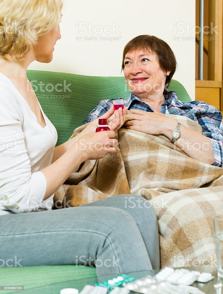 mature women with liquid medicine stock photo